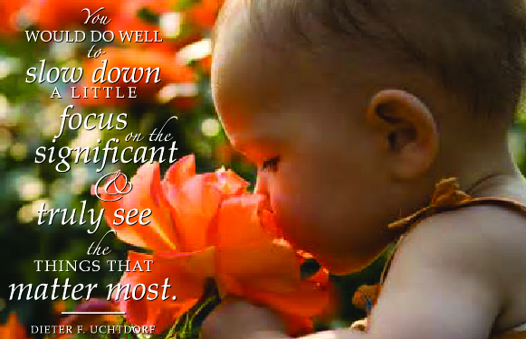 Mindfulness quote on an image of a baby smelling an apricot coloured rose
