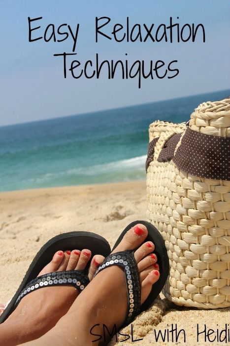Relaxation on the beach and female feet with red-painted toenails