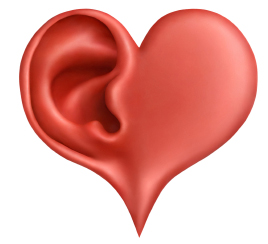 Red heart with the imprint of an ear to demonstrate mindful listening - a mindfulness exercise
