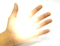 left hand with light energy emanating from palm