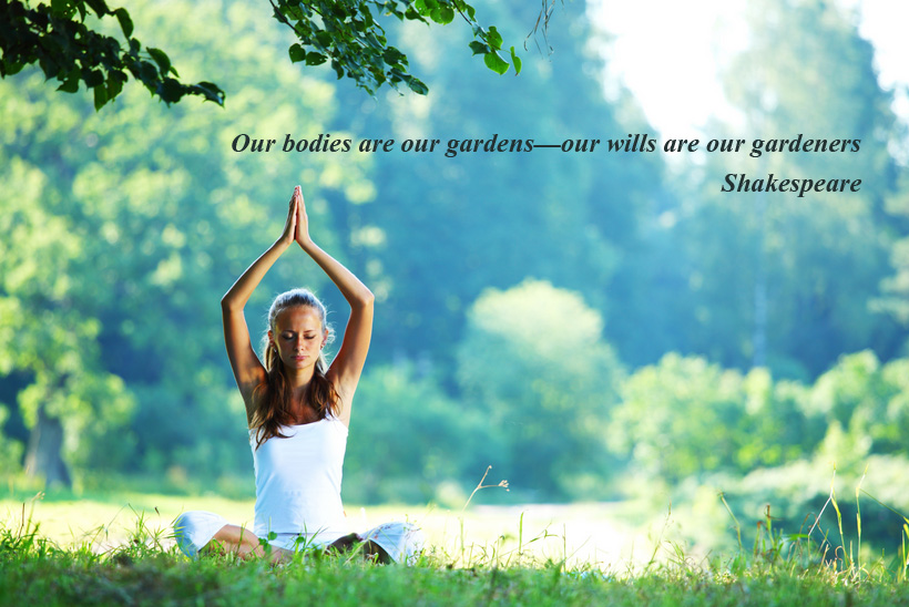 mindfulness yoga quote on image of woman sat in field practising yoga with tree in background