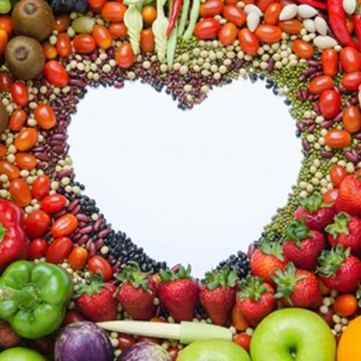 selection of fruit, veg, grains and pulses making outline of a heart shape