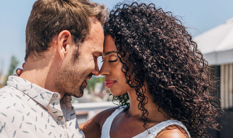 embracing couple showing how mindful meditation can improve relationships
