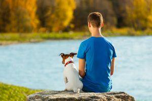 boy-with-dog-lake-300x200