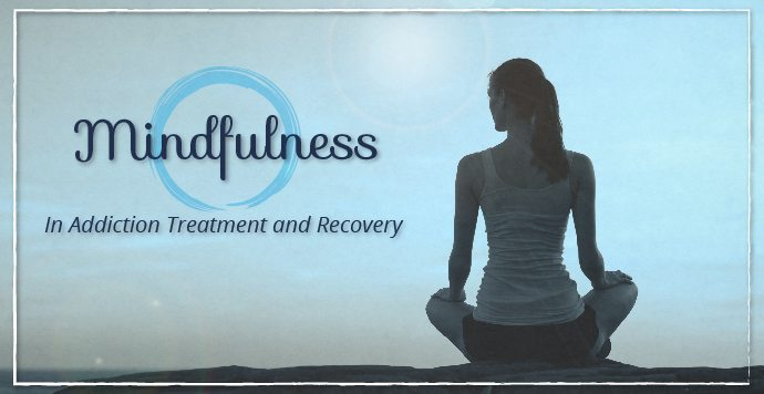 quote about mindfulness and addiction with image of woman sat cross-legged on beach