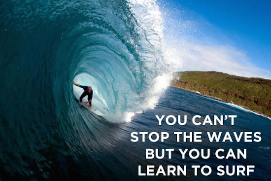 inspirational quote on image of surfer going through pipe wave