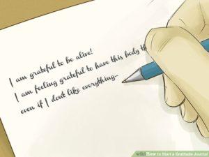 Gratitude journal being written in